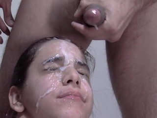 Smallish tits dark haired glazed in jizm bukkake